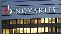 Novartis splits drugs business into two, pharma chief to leave